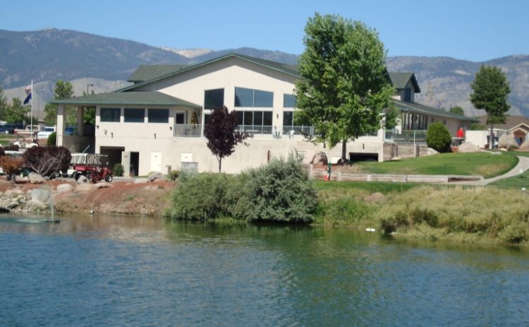 A clubhouse is seen beyond a pond at Empire Ranch Golf Course in Carson City, Nevada