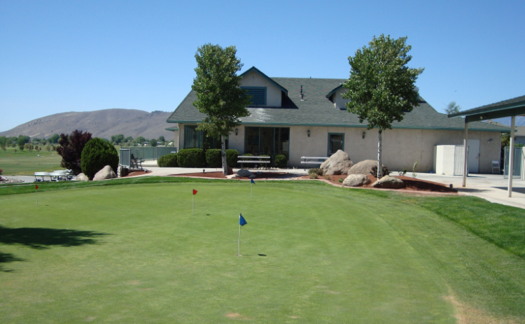 The lawn is freshly mowed in front of the clubhouse at Empire Ranch Golf Course in Carson City, Nevada