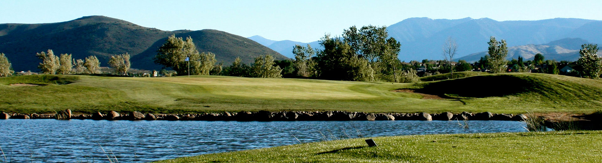 A hole is pictured past a pond at Empire Ranch Golf Course in Carson City, Nevada